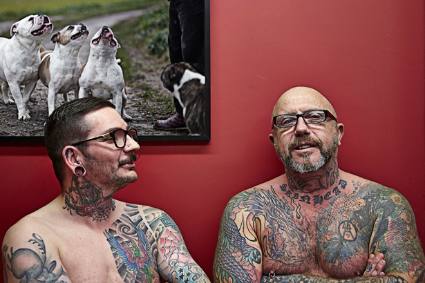 Two middle aged tattooists